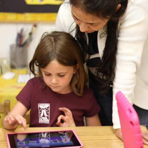 Seven Arrows Academic 5 - Teacher teaching little girl